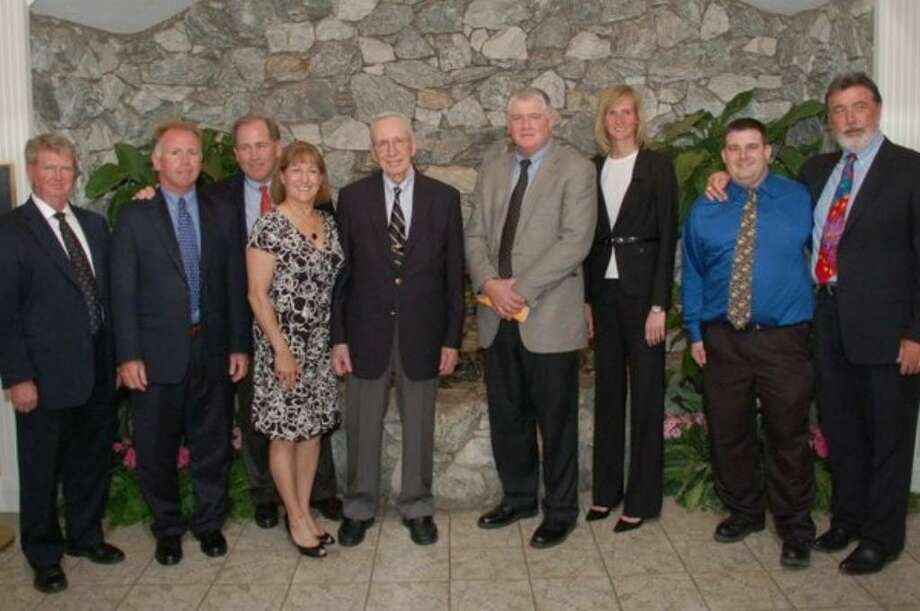 The Sportsmen of Westport honored, from left, Neil Harding, Kevin Murphy, Ed Murphy, Mary Martinik, Sam Freedman, Bob Wickey, Carolyn Center, Kevin Lippert and Mark Skinner at its dinner in May. Photo: Contributed Photo