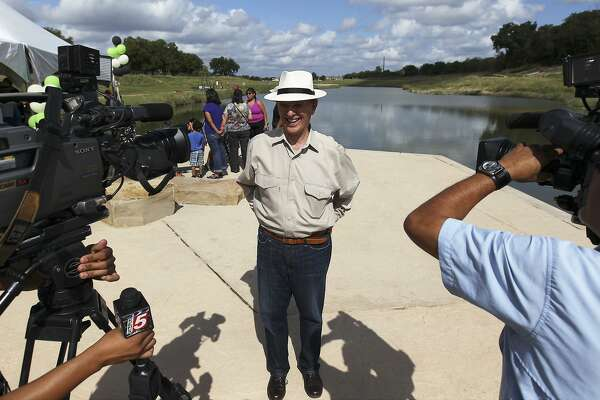 Bexar County Judge Nelson Wolff talks to the media about the Mission Reach Ecosystem Restoration and Recreation Project along the San Antonio River in October 2013. It's one of six projects discussed in Wolff's new book.