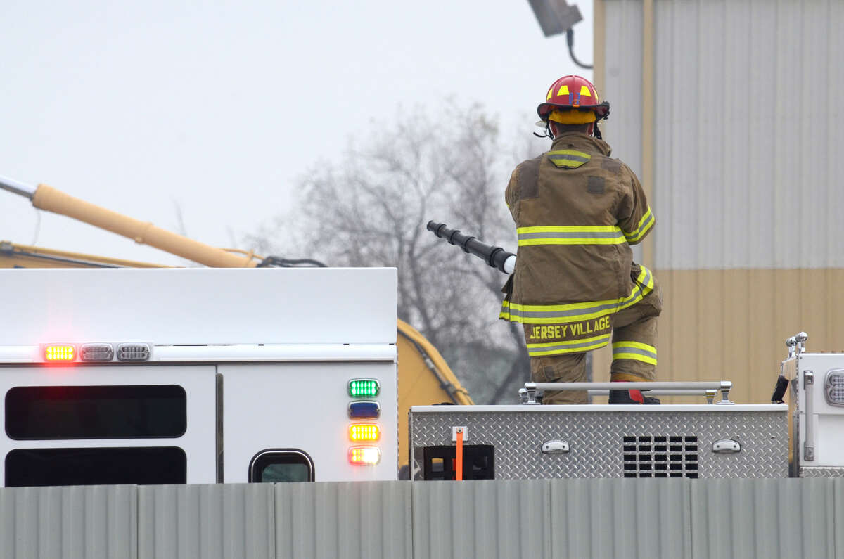 A Jersey Village firefighter at the scene of the trash fire in which a propane tank exploded on Tuesday, Jan. 15, 2019.