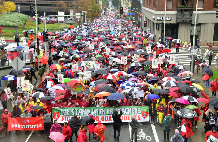 Thousands of teachers march in the rain through Los Angeles, California on January 14, 2019, on the first day of the first teachers strike in 30 years targeting the Los Angeles Unified School District (LAUSD). - Teachers of the LAUSD, the second largest public school district in the US, are striking for smaller class size, better school funding and higher teacher pay. (Photo by Frederic J. BROWN / AFP) (Photo credit should read FREDERIC J. BROWN/AFP/Getty Images)