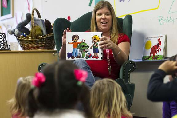 FILE - In this Feb. 13, 2015 file photo, Lakeside preschool teacher Nicki Fisher reads a story about an alien to her class as part of a Harmony Program lesson on possibilities and empathy, in Lakeside, Calif. California Gov. Gavin Newsom is preparing to release his first state budget, offering his clearest outline yet of his plan to significantly boost spending on health care and services for children while maintaining his promise to be fiscally prudent. Newsom plans to discuss his proposal during a news conference in Sacramento on Thursday, Jan. 10, 2019. (Nelvin C. Cepeda/The San Diego Union-Tribune via AP, File)
