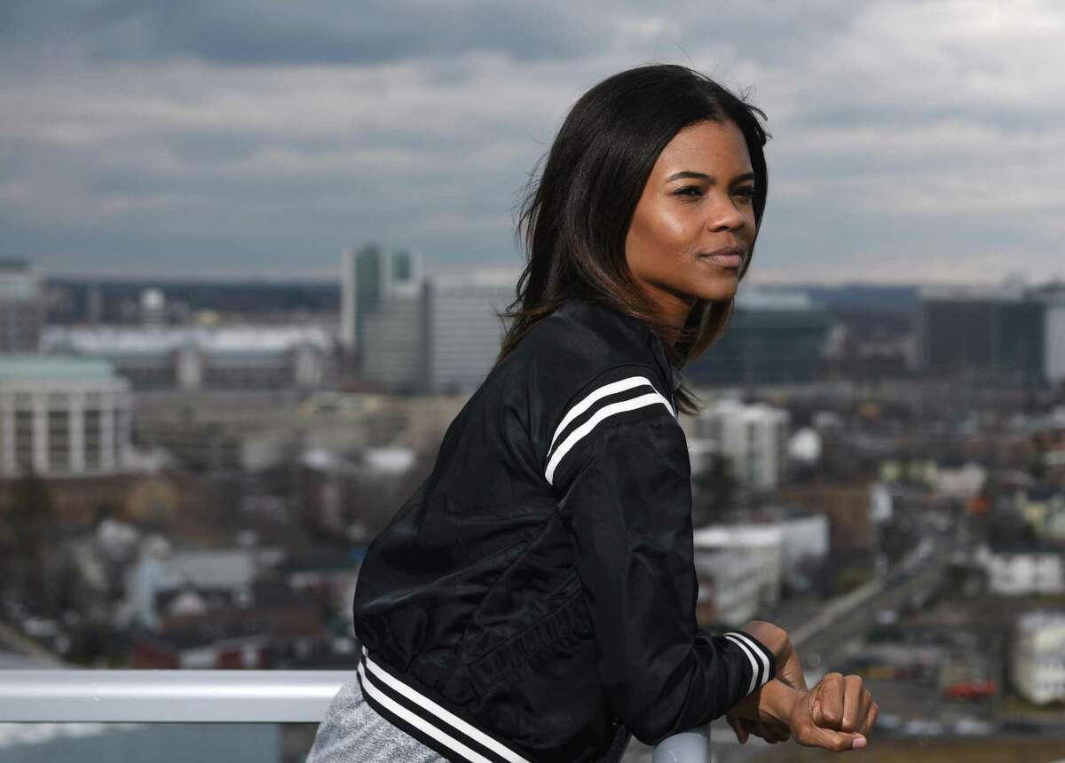 Degree180 CEO Candace Owens poses overlooking the city from her home office in Stamford, Conn. Monday, Feb. 29, 2016. Owens was bullied with racist threats as a student in high school and is now launching an anti-bullying website, Social Autopsy, which launches its beta version on Friday, March 4.