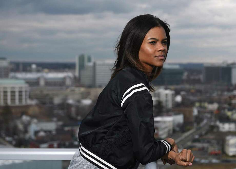 Candace Owens poses overlooking the city from her home office in Stamford, Conn. Monday, Feb. 29, 2016. Photo: Tyler Sizemore / Hearst Connecticut Media / Greenwich Time