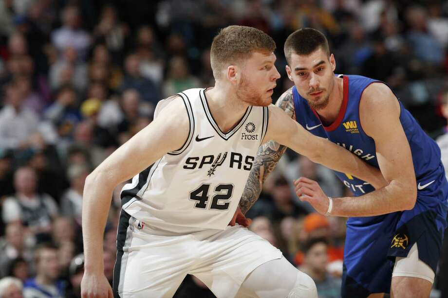 San Antonio Spurs forward Davis Bertans (42) and Denver Nuggets forward Juan Hernangomez (41) in the first half of an NBA basketball gsm Friday, Dec. 28, 2018, in Denver. (AP Photo/David Zalubowski) Photo: David Zalubowski, STF / Associated Press / Copyright 2018 The Associated Press. All rights reserved.