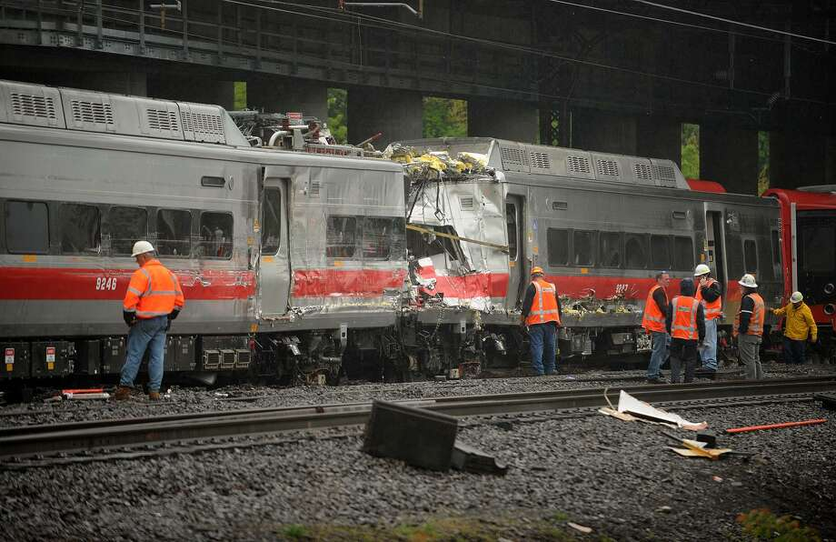Metro North workers prepare train cars to be pulled from the scene of Friday's derailment in Bridgeport. Conn. on Sunday, May 19, 2013. Photo: Brian A. Pounds / Brian A. Pounds / Connecticut Post