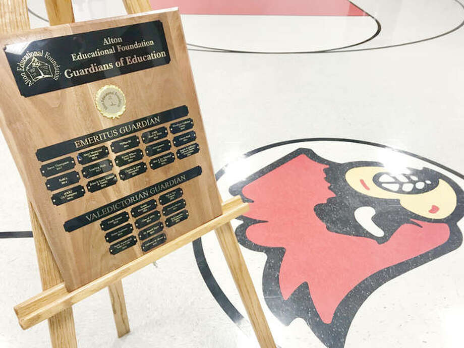 A plaque displaying names of top donors to the Alton Educational Foundation's Guardians of Education sits in the gym of Alton's Mark Twain School.