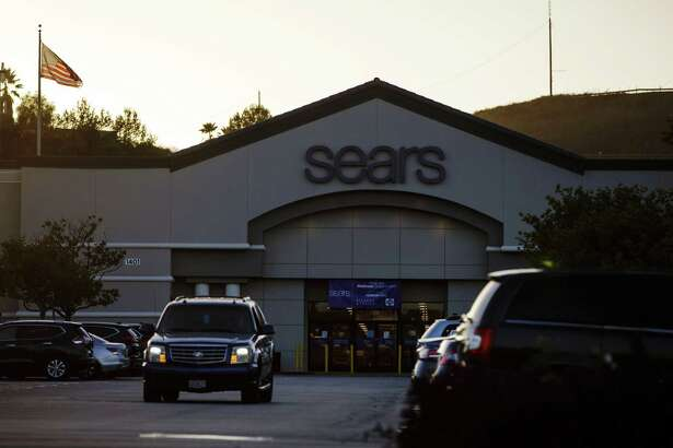 A car drives through the parking lot of a Sears Holdings Corp. store in Montebello, California, on Oct. 10, 2018.
