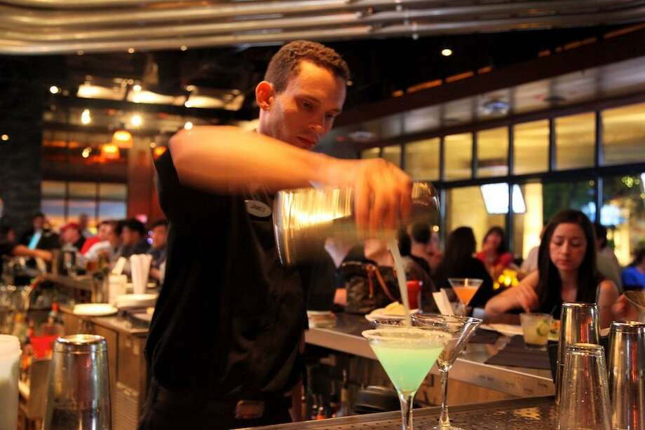 A Yard House bartender mixes drinks at a location in San Antonio, Texas. Heading into 2019, the chain filed for permission from Connecticut regulators to open an establishment in South Norwalk, Conn. Photo By Xelina Flores-Chasnoff Photo: Xelina Flores-Chasnoff / Special To The Express-News / SAN ANTONIO EXPRESS-NEWS