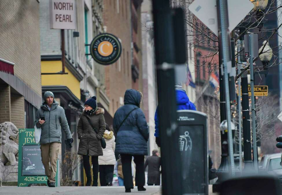 People make their way in the cold through the downtown area on Tuesday, Jan. 15, 2019, in Albany, N.Y. . (Paul Buckowski/Times Union)
