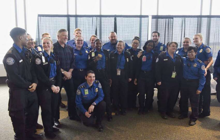 Actor Treat Williams, fourth from left, poses for a photo with TSA employees at the Albany International Airport on Tuesday, Jan. 15, 2019, in Colonie, N.Y. Williams, who lives in Vermont and flies out of Albany often, wanted to do something to show his appreciation for the work that TSA employees and air traffic controllers do. (Paul Buckowski/Times Union)