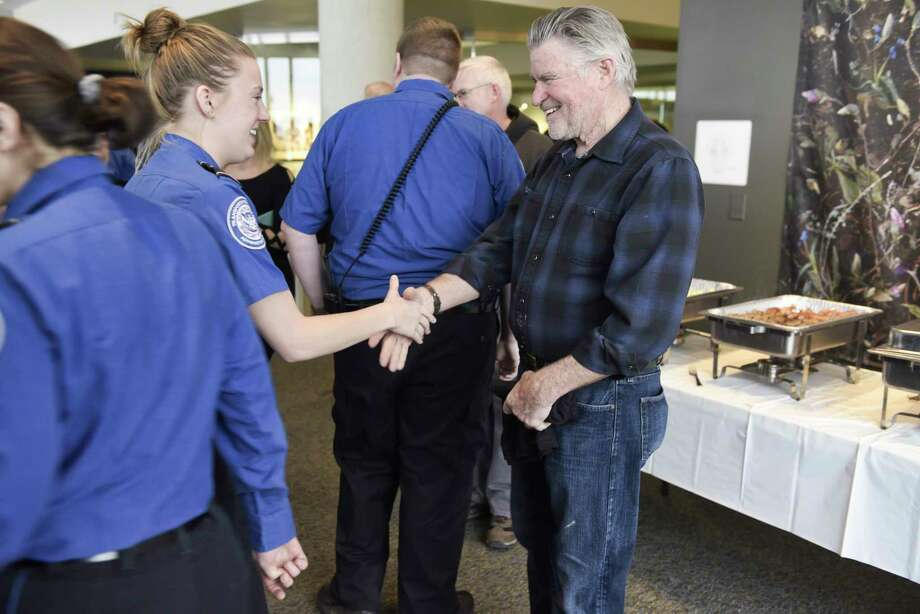 Actor Treat Williams, right, greets TSA employees at the Albany International Airport on Tuesday, Jan. 15, 2019, in Colonie, N.Y. Williams, who lives in Vermont and flies out of Albany often, wanted to do something to show his appreciation for the work that TSA employees and air traffic controllers do.      (Paul Buckowski/Times Union) Photo: Paul Buckowski, Albany Times Union / (Paul Buckowski/Times Union)
