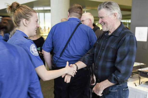 Actor Treat Williams, right, greets TSA employees at the Albany International Airport on Tuesday, Jan. 15, 2019, in Colonie, N.Y. Williams, who lives in Vermont and flies out of Albany often, wanted to do something to show his appreciation for the work that TSA employees and air traffic controllers do. (Paul Buckowski/Times Union)