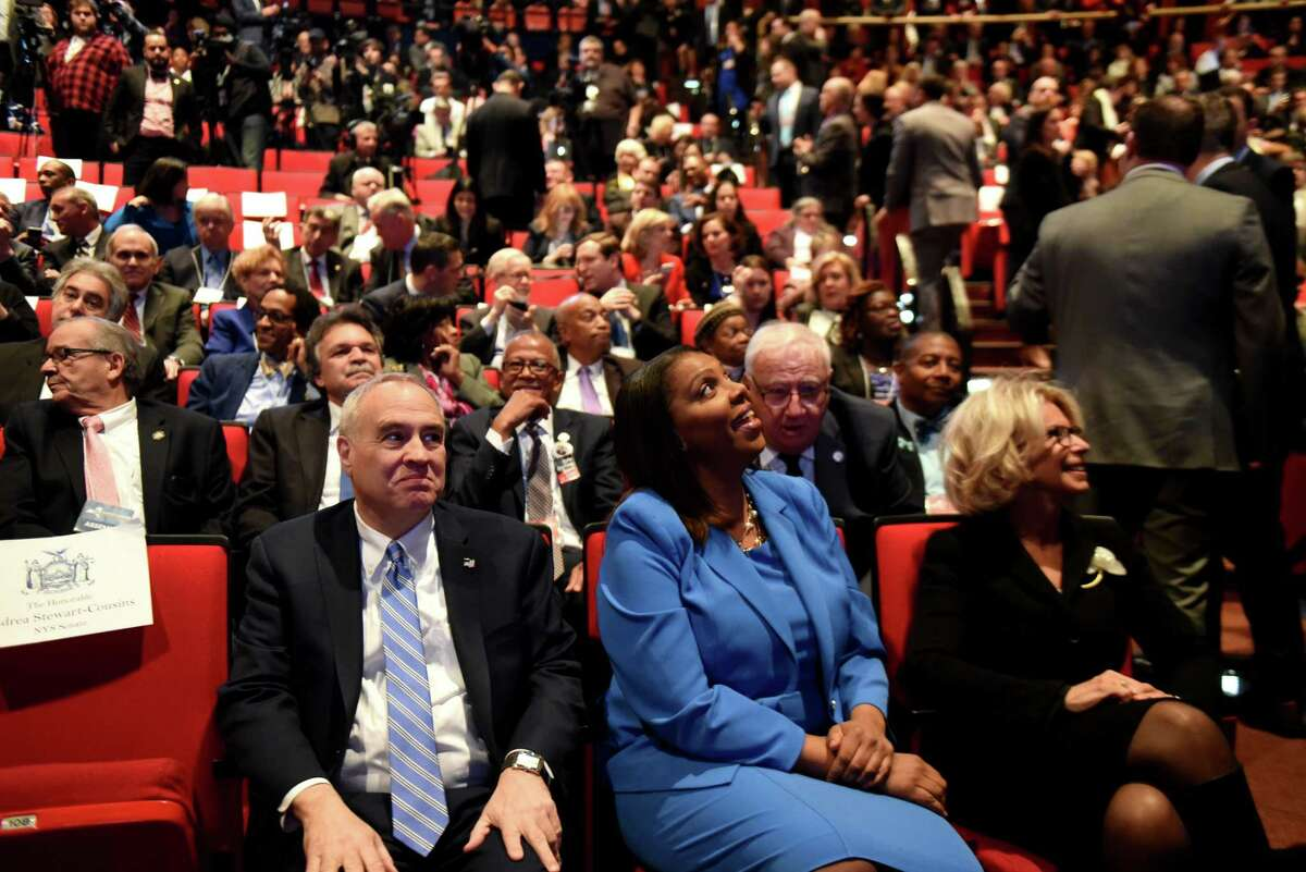 State Comptroller Thomas P. DiNapoli, left, State Attorney General Letitia James, center, and Janet DiFiore, chief judge of the Court of Appeals and the State of New York, right, take a seat before the start of Gov. Andrew Cuomo's budget address and state of the state on Tuesday, Jan. 15, 2019, at The Egg in Albany, N.Y. (Will Waldron/Times Union)