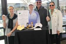 Wilton Library's mini golf committee is gearing up for the two fundraisers: the Mini Golf Tourney for Adults on Friday, Jan. 25, and the Family Day Mini-Golf on Saturday, Jan. 26. From left: Teresa DiLorenzo-Waldron, Carolina Corrigan, Gary Battaglia and Margret Greene.