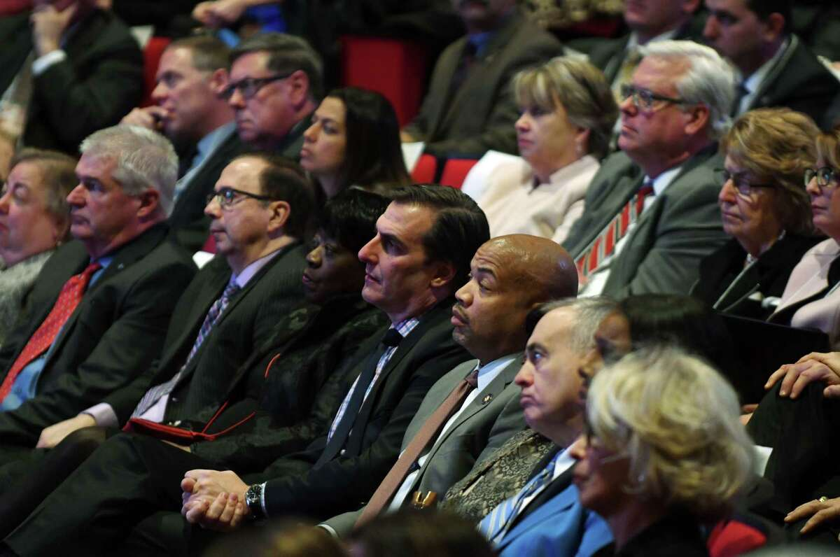 Speaker Carl Heastie, center, sits with Sen. Michael Gianaris, to his left, and State Comptroller Thomas P. DiNapoli, right, as they listen to Gov. Andrew Cuomo's budget address and state of the state on Tuesday, Jan. 15, 2019, at The Egg in Albany, N.Y. (Will Waldron/Times Union)