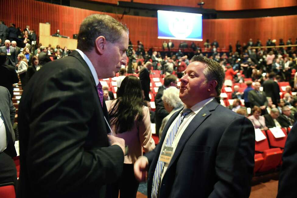 Albany County Executive Dan McCoy, right, speaks with former Lt. Governor Robert Duffy before the start of Gov. Andrew Cuomo's budget address and state of the state on Tuesday, Jan. 15, 2019, at The Egg in Albany, N.Y. (Will Waldron/Times Union)