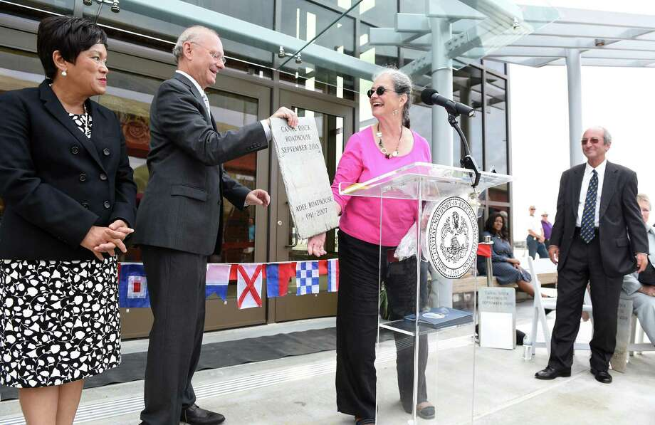 In this file photo, fFormer New Haven City Plan Administrator Karyn Gilvarg (center) is given a ceremonial plaque made from a salvaged piece of roof slate from the Adee Boathhouse commemorating the building of the Canal Dock Boathouse in New Haven by then-Economic Development Administrator Matthew Nemerson during a ribbon cutting ceremony on September 17, 2018. At left is New Haven Mayor Toni Harp and at right is University of New Haven president Steven Kaplan. Photo: Arnold Gold / Hearst Connecticut Media / New Haven Register