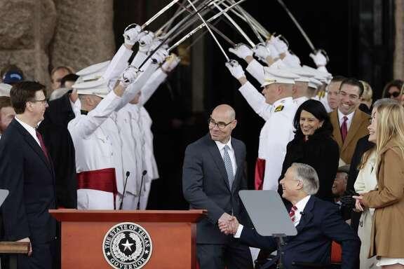 House Speaker Dennis Bonnen, center, congratulates Gov. Greg Abbott, right, and Texas Lt. Gov. Dan Patrick, left, during their inauguration ceremony, in Austin, Texas, Tuesday, Jan. 15, 2019. (AP Photo/Eric Gay)