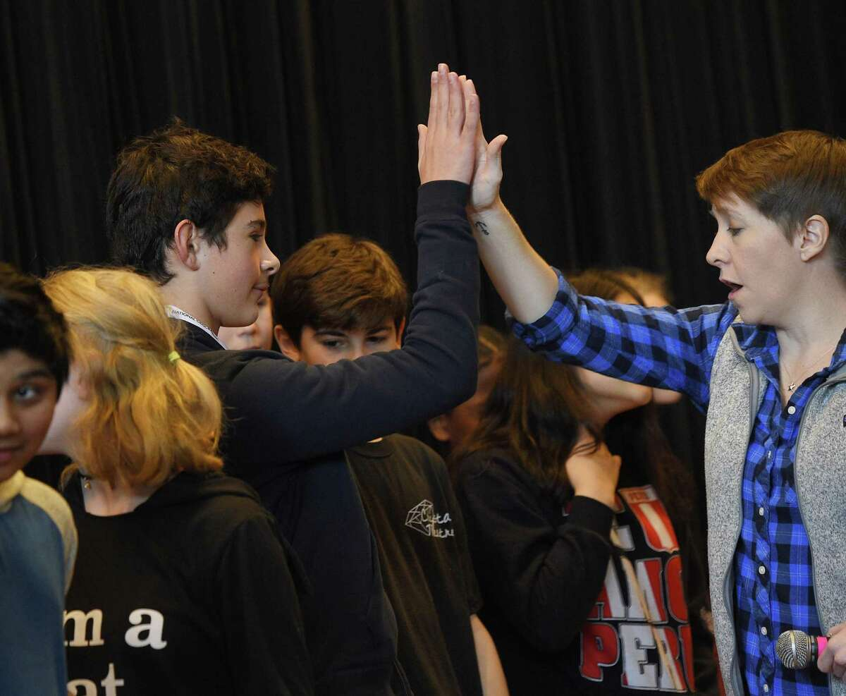 Eighth-grader John Bova gets a high five from Student Council President Angela Nida after winning the National Geographic Geography Bee at Nathan Hale Middle School in Norwalk, Conn. Tuesday, Jan. 15, 2019. 18 students competed in the multi-round single-elimination competition featuring a variety of U.S. and international questions. Eighth-grader John Bova won the competition and will advance to the state competition with a chance to go to Nationals.