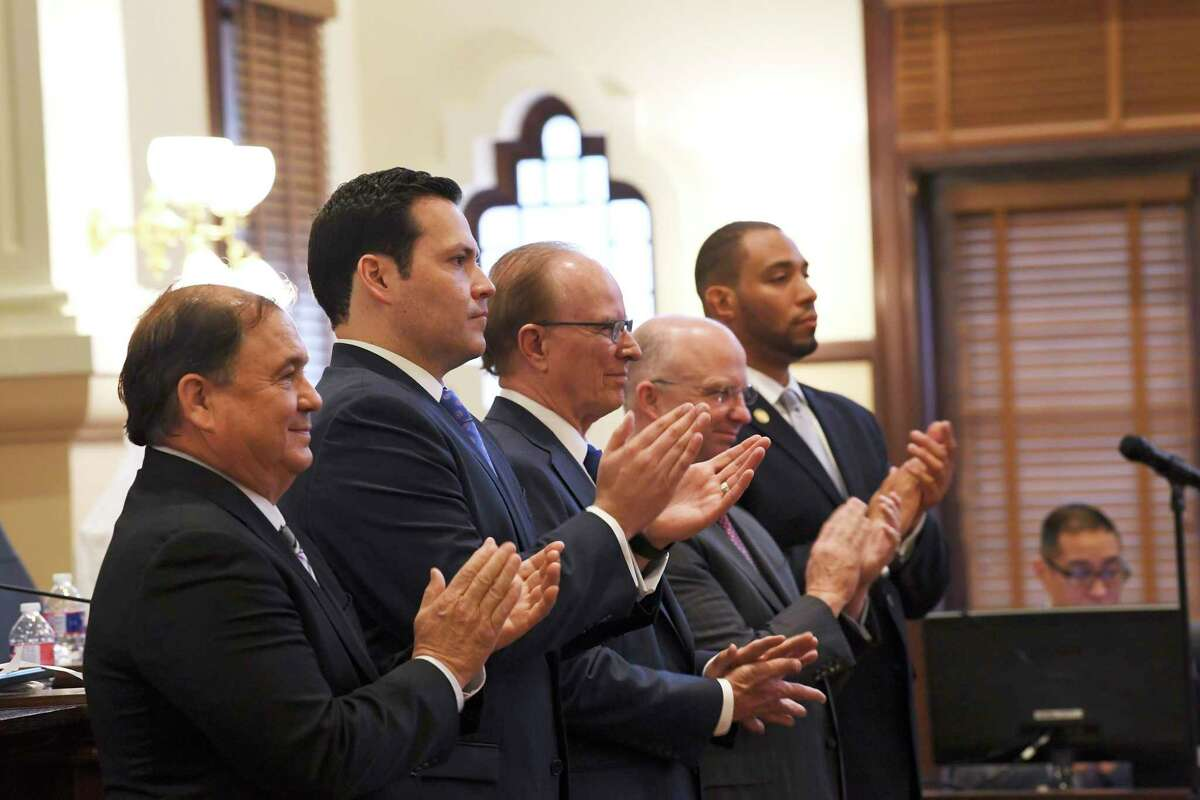 """Members of the Bexar County Commissioners Court applaud county employees celebrating work anniversaries in January. County Judge Nelson Wolff, middle, is joined by commissioners, from left, Sergio """"Chico"""" Rodriguez, Juston Rodriguez, Kevin Wolff and Tommy Calvert. It was the commissioners' first meeting of the year."""