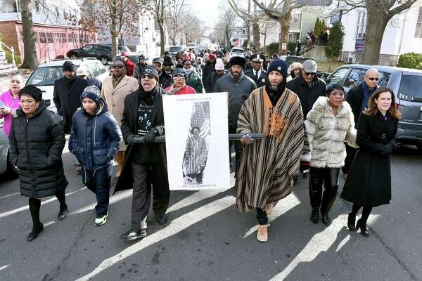 Rev. Kennedy D. Hampton, Sr., (left center) and Rev. George Hampton, III, (center right) lead the 49th Annual Dr. Martin Luther King, Jr., Love March beginning at the Shiloh Missionary Baptist Church in New Haven on January 15, 2019.The 49th Annual Dr. Martin Luther King, Jr., Love March begins at the Shiloh Missionary Baptist Church in New Haven on January 15, 2019.