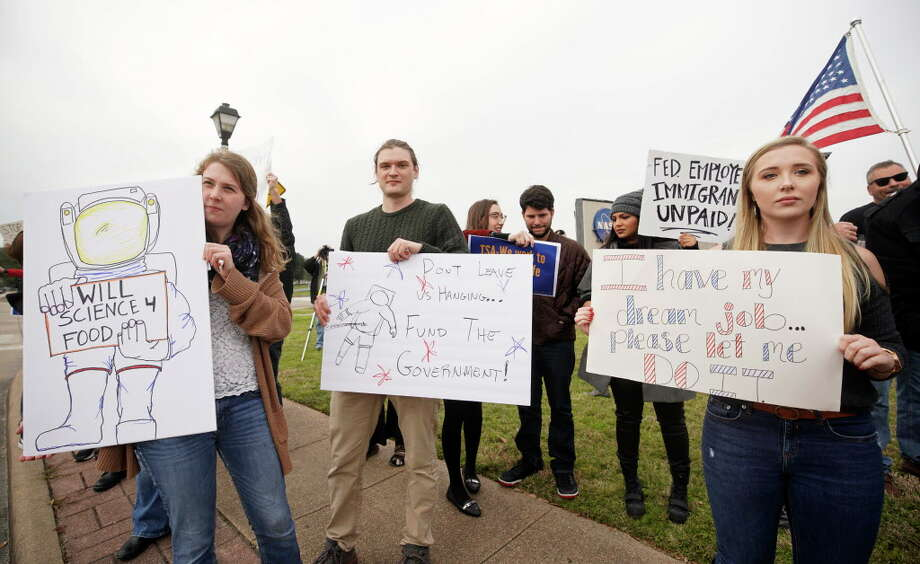 Kirsi Kuutti of Duluth, MN, left, Desmond O'Connor of Dickinson, center, and Sandra Jones, right, who was about to start a NASA job, protest with others outside of NASA's Johnson Space Center against the government shutdown Tuesday, Jan. 15, 2019, in Houston. Photo: Melissa Phillip, Staff Photographer / © 2019 Houston Chronicle