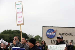 People protest outside of NASA's Johnson Space Center against the government shutdown Tuesday, Jan. 15, 2019, in Houston.
