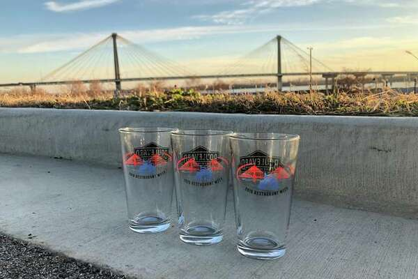 This year's Alton Restaurant Week souvenir glass features the iconic Alton Clark Bridge with a paddle wheel riverboat.