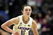 UConn's Molly Bent drives downcourt in a Jan. 9 game against Cincinnati in Storrs.