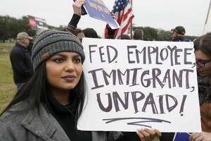 Paromita Mitra, a NASA engineer, protests with others outside of NASA's Johnson Space Center against the government shutdown Tuesday, Jan. 15, 2019, in Houston.