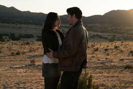 "Jeanine Mason as Liz Ortecho and Nathan Parsons as Max Evans in ""Roswell, New Mexico."" (Ursula Coyote/The CW)"