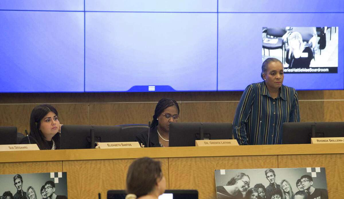 Houston Independent School District Board of Education Trustees Elizabeth Santos, left, Rhonda Skillern-Jones, right, and Interim Superintendent Dr. Grenita Lathan listen to an agenda speaker voice against the school district to seeking outside partners to run several long-struggling schools during a HISD meeting on Thursday, Dec. 13, 2018, in Houston.