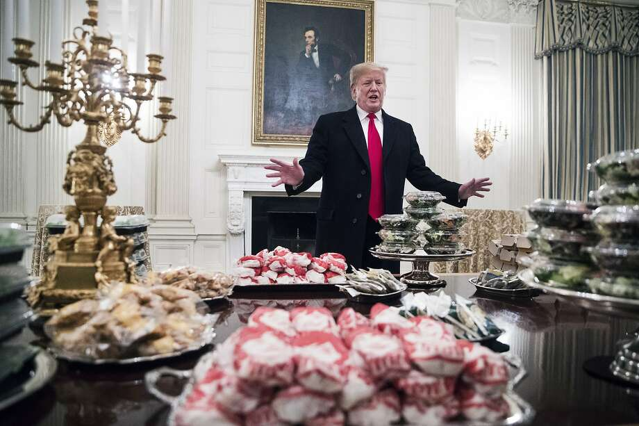 President Donald Trump gives remarks in front of the fast food that was served to the Clemson Tigers, the winners of the 2018 College Football Playoff National Championship, at the White House in Washington, Jan. 14, 2019. The fine dining that is typical for visiting players was substituted with fast food because of the government shutdown, Trump said.(Sarah Silbiger/The New York Times) Photo: Sarah Silbiger, NYT