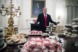 President Donald Trump gives remarks in front of the fast food that was served to the Clemson Tigers, the winners of the 2018 College Football Playoff National Championship, at the White House in Washington, Jan. 14, 2019. The fine dining that is typical for visiting players was substituted with fast food because of the government shutdown, Trump said.(Sarah Silbiger/The New York Times)