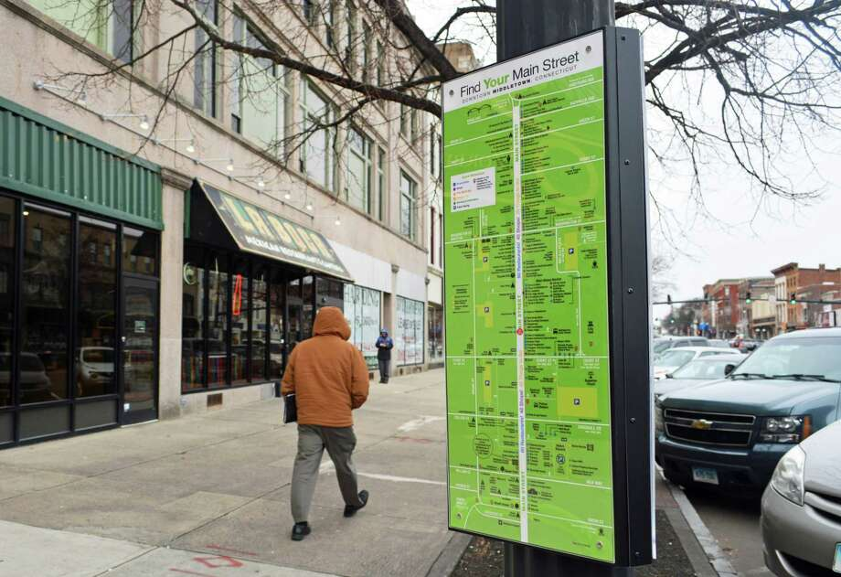 Middletown's Downtown Business District has installed wayfinding signs along Main Street, each of which includes a map of the area and short profile of a business person or stories about familiar faces. Photo: Cassandra Day / Hearst Media Connecticut