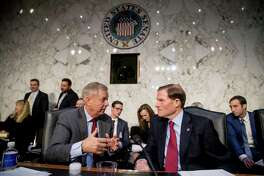 Senate Judiciary Committee Chairman Lindsey Graham, R-S.C., left, speaks with Sen. Richard Blumenthal, D-Conn., right, during a break from testimony from Attorney General nominee William Barr at a Senate Judiciary Committee hearing on Capitol Hill in Washington, Tuesday, Jan. 15, 2019. (AP Photo/Andrew Harnik)