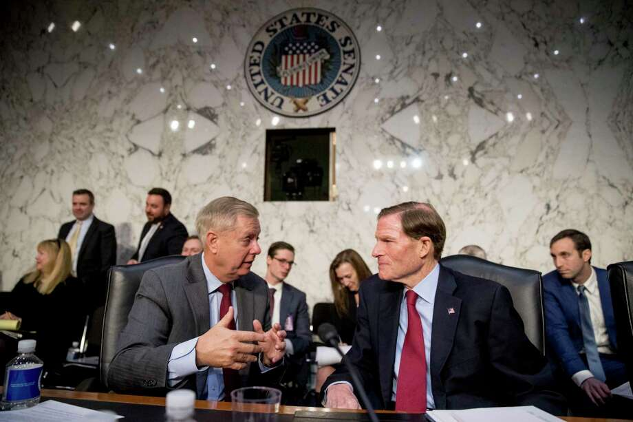 Senate Judiciary Committee Chairman Lindsey Graham, R-S.C., left, speaks with Sen. Richard Blumenthal, D-Conn., right, during a break from testimony from Attorney General nominee William Barr at a Senate Judiciary Committee hearing on Capitol Hill in Washington, Tuesday, Jan. 15, 2019. (AP Photo/Andrew Harnik) Photo: Andrew Harnik / Associated Press / Copyright 2019 The Associated Press. All rights reserved