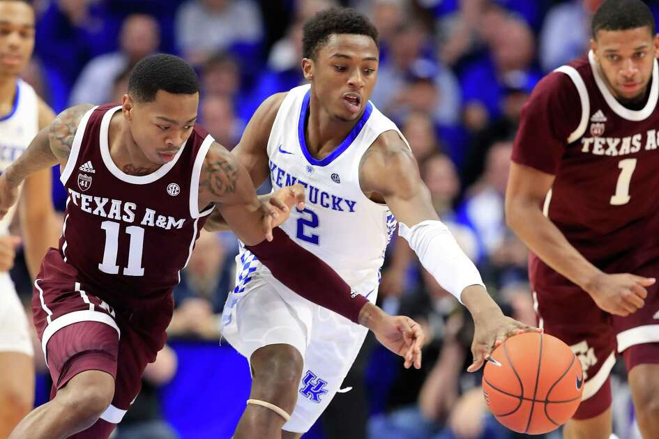LEXINGTON, KY - JANUARY 08: Ashton Hagans #2 of the Kentucky Wildcats reaches for a loose ball against the Texas A&M Aggies at Rupp Arena on January 8, 2019 in Lexington, Kentucky.