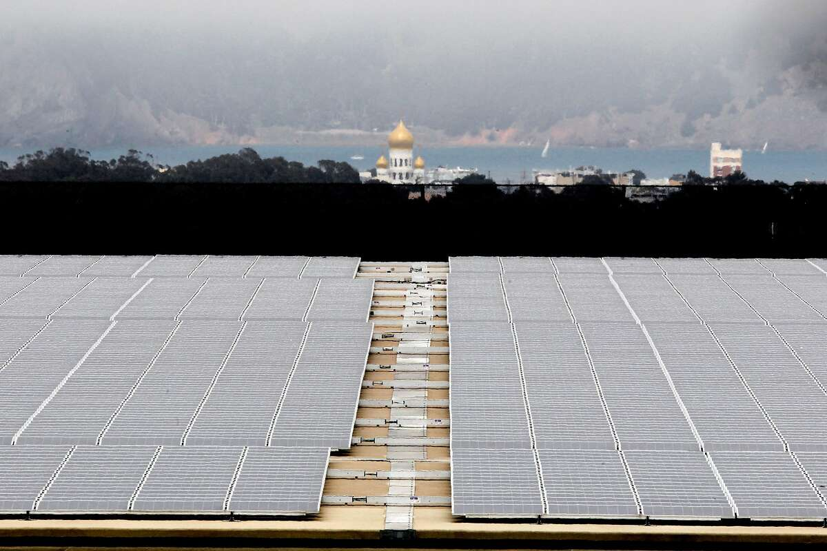 The roof of the Sunset Reservoir, in San Francisco, Calif., on Saturday Sept. 15,2012, is covered with solar panels. After eight years, San Francisco is on the threshold of taking a major step into the public power realm. The Board of Supervisors is set to consider legislation Tuesday (Sept. 18) that will allocate $19.5 million to secure a contract with Shell Energy North America to provide 100 percent renewable power to San Franciscans who want to pay a premium for it, with $2 million of that total allocated to studying local power generation options. The program, CleanPowerSF, is designed to build a customer base and revenue stream to lay the groundwork for city-owned renewable power generation while advancing San Francisco's aggressive greenhouse gas reduction goals.