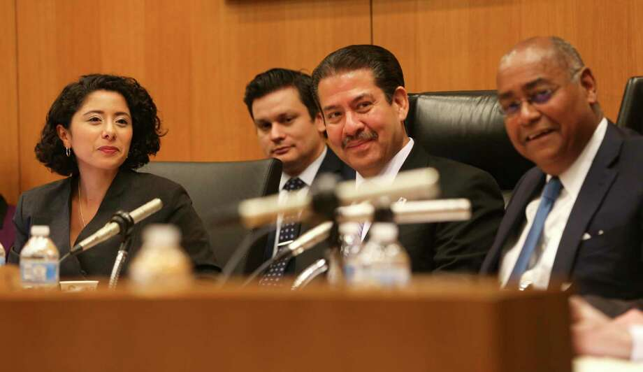 Newly-elected Harris County Judge Lina Hidalgo, left, presides her first Harris County Commissioners Court with commissioners Adrian Garcia and Rodney Ellis on Tuesday, January 8, 2019 in Houston. Photo: Elizabeth Conley, Houston Chronicle / Staff Photographer / © 2018 Houston Chronicle