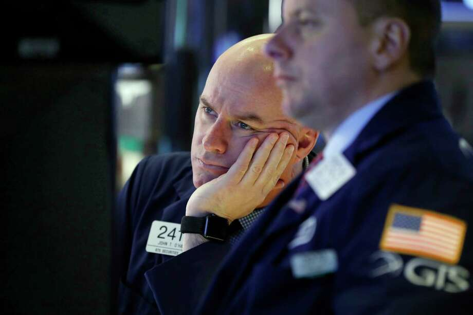 nullFILE- In this Jan. 11, 2019, file photo, Specialist John O'Hara, left, works on the floor of the New York Stock Exchange. The U.S. stock market opens at 9:30 a.m. EST on Tuesday, Jan. 15. (AP Photo/Richard Drew, File) Photo: Richard Drew / Copyright 2018 The Associated Press. All rights reserved