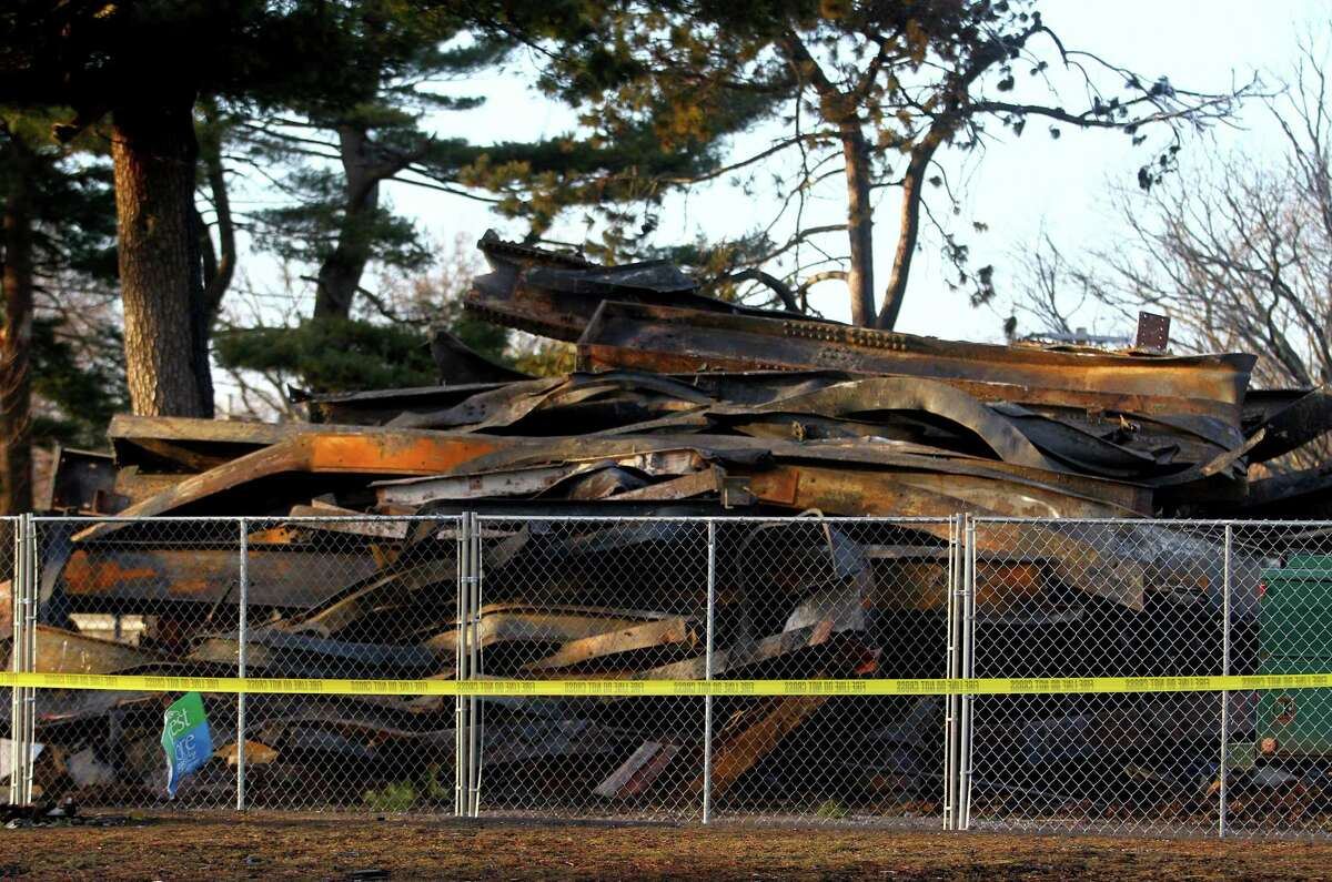 Clean-up continues after a fire destroyed the old theater at American Shakespeare State Park in Stratford, Conn. on Tuesday Jan. 15, 2019. Though the circumstances of the blaze have led many to speculate on its cause, Fire Marshal Brian Lampart said investigators have no evidence of arson at the property ?- though he cautioned the investigation is also in its early stages.