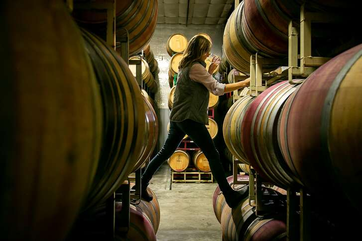 Winemaker Mandy Heldt Donovan tastes the 2018 Pinot Gris from the barrel at her custom crush winery in Sonoma, Calif. on November 30th, 2018.