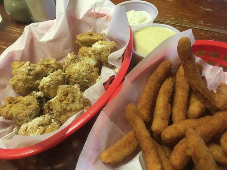 Fried mushrooms ($3.95) and an order of chicken fries ($3.25) with honey mustard and gravy dipping sauces at Bobby J's.