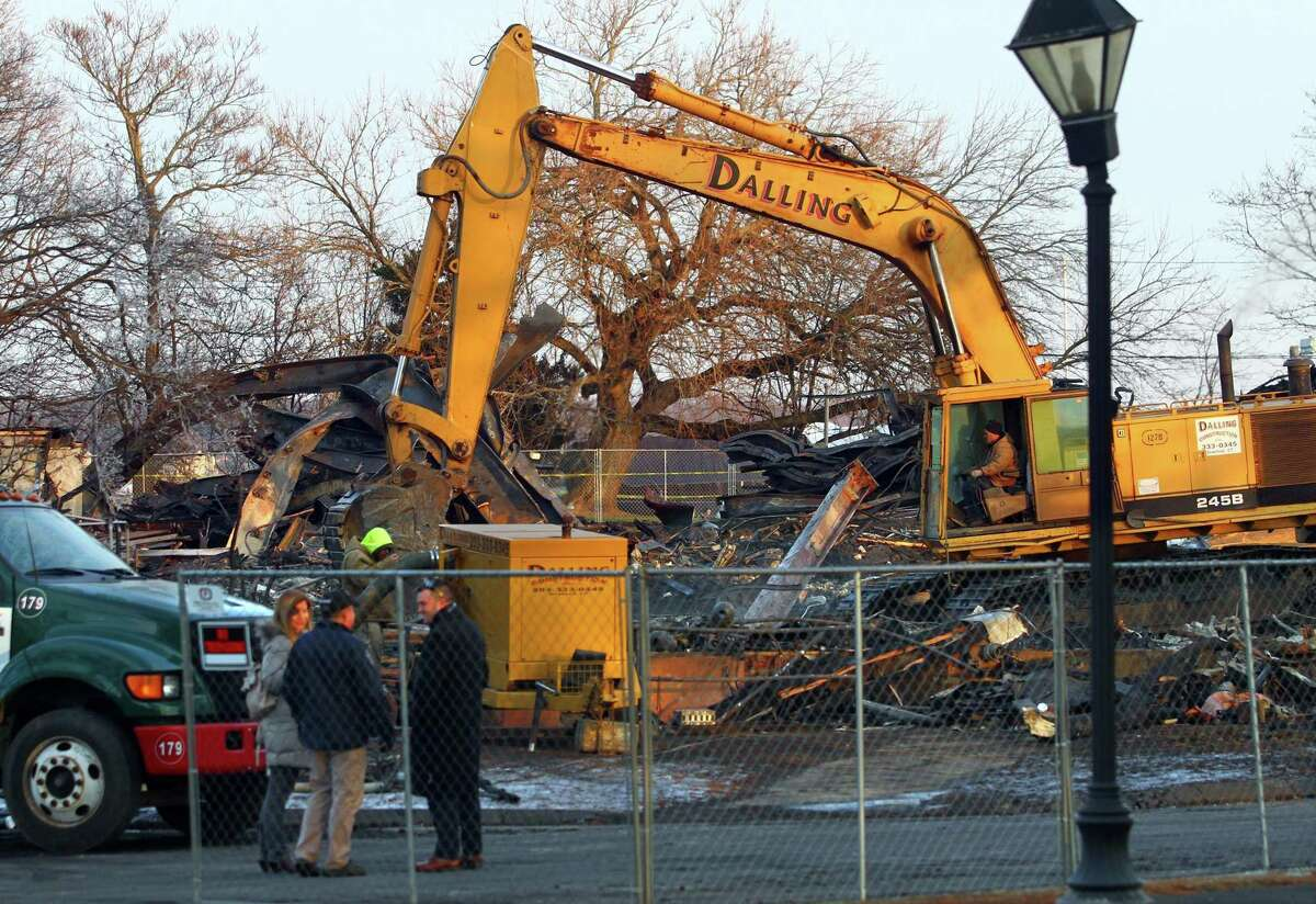 Clean-up continues after a fire destroyed the old theater at American Shakespeare State Park in Stratford, Conn. on Tuesday Jan. 15, 2019. Though the circumstances of the blaze have led many to speculate on its cause, Fire Marshal Brian Lampart said investigators have no evidence of arson at the property - though he cautioned the investigation is also in its early stages.