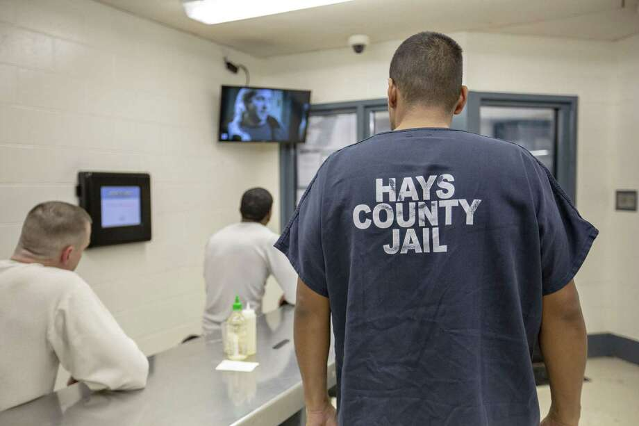 Inmates watch television, read books, play games and do their own thing in a part of an overcrowded Hays County Jail on Dec. 20. The overcrowding could be because of lack of judicial work ethic. Photo: Thao Nguyen / / Thao Nguyen