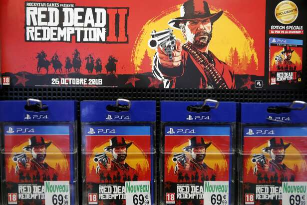 PARIS, FRANCE - OCTOBER 27: Red Dead Redemption 2 (RD 2) video games for Sony PlayStation PS4 developed by Rockstar Studios and published by Rockstar Games are displayed inside a shop during the 'Paris Games Week' on October 27, 2018 in Paris, France. 'Paris Games Week' is an international trade fair for video games and runs from October 26 to 31, 2018. (Photo by Chesnot/Getty Images)