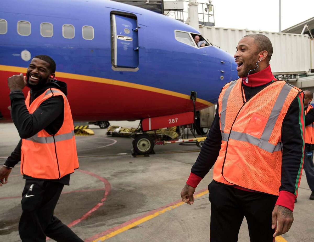 PHOTOS: Check out Rockets players working at Hobby Airport on Tuesday Houston Rockets players James Ennis III, left, and PJ Tucker walk into the ramp area at William P. Hobby Airport on Tuesday, Jan. 15, 2019, in Houston. The Rockets players teamed up with Southwest Airlines to surprise travelers at Hobby Airport. Southwest employees joined the players, Clutch the Bear, and members of the Rockets Power Dancers in greeting and interacting with customers at the airport while helping to perform duties such as announcing flight information and collecting boarding passes. Browse through the photos above to see the Rockets players in action at Hobby Aiport ...
