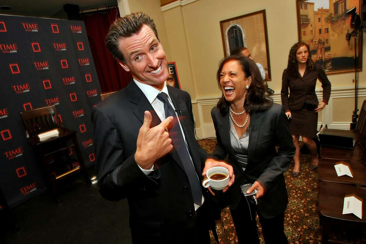 Gavin Newsom and Kamala Harris laugh at a Time magazine breakfast for up and coming politicians as part of the Democratic National Convention, Aug. 26, 2008, in Denver, Colorado.