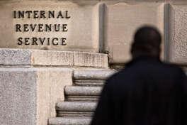 A man walks past IRS headquarters in Washington on Oct. 20, 2017.